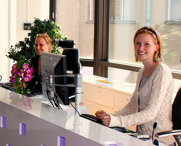 Receptionists_By_Evan_Bench-from_paris,_france_(Reception)__[CC-BY-SA-2.0_(http_creativecommons.org_licenses_by-sa_2.0)]_via_Wikimedia_Common